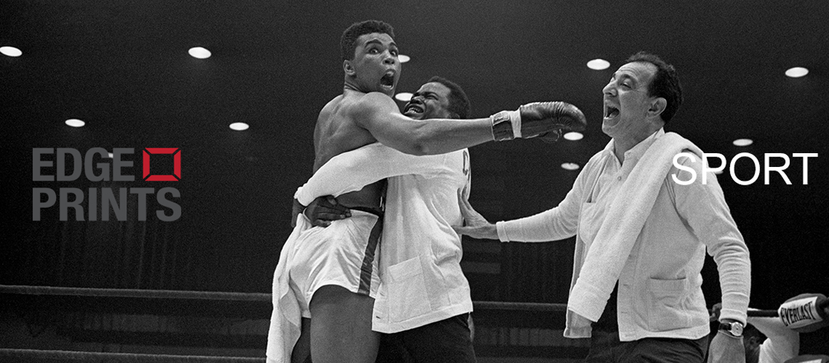 Cassius Clay (later Muhammad Ali) is embraced by his handlers after he won the world heavyweight championship on a TKO over Sonny Liston in the 7th round. 25th February, 1964. (Photo by Bettmann)