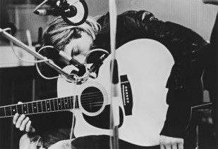 Cobain Resting on his Guitar